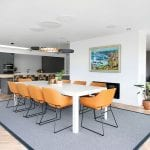 dining-area-in-open-plan-kitchen-with-orange-chairs