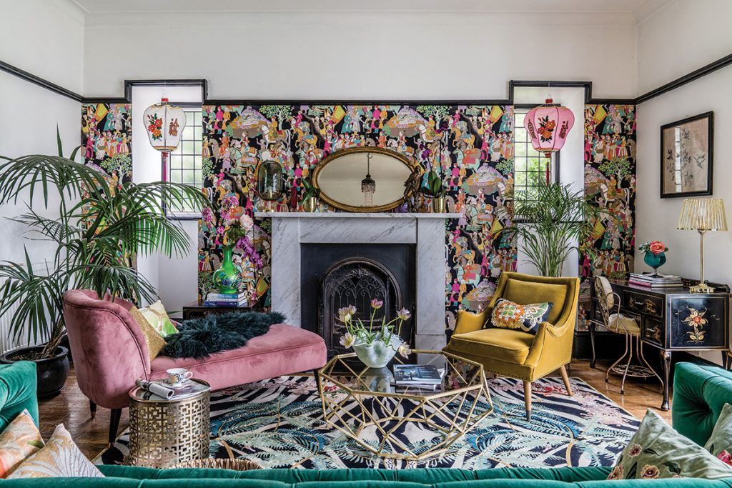 living-room-with-brightly-patterned-wallpaper-and-gold-furniture