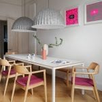 dining-room-with-wood-and-grey-lampshades-and-neon-pink-prints