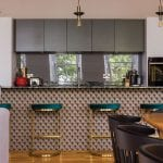 kitchen-with-green-stools-and-grey-cupboards