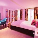 bedroom-with-neon-light-and-timourous-beasties-fabric