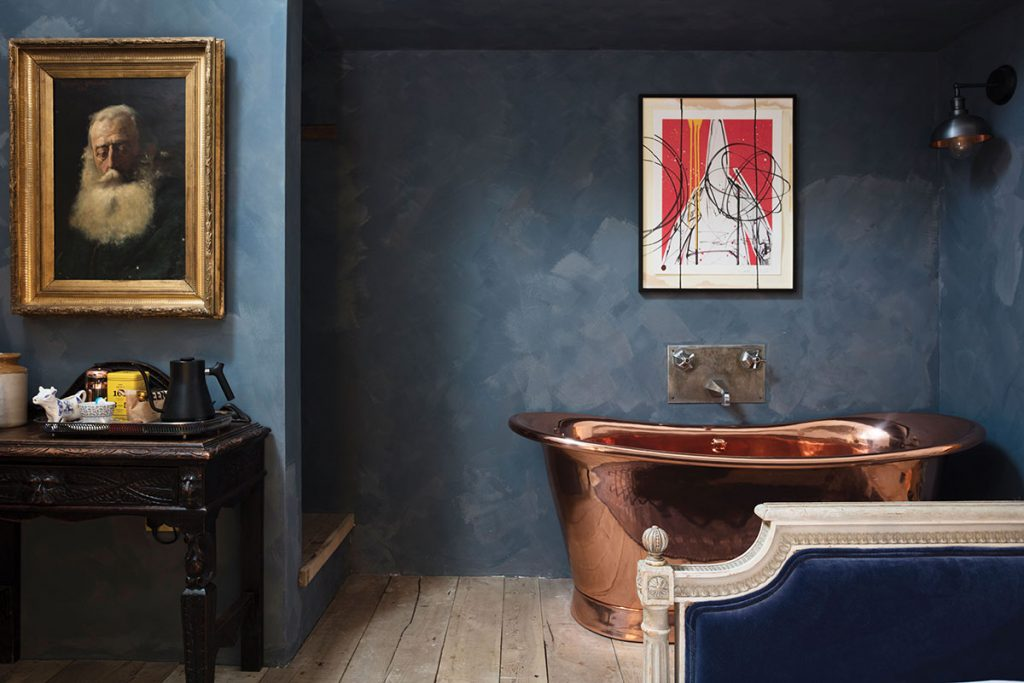 blue-bedroom-with-copper-freestanding-bath