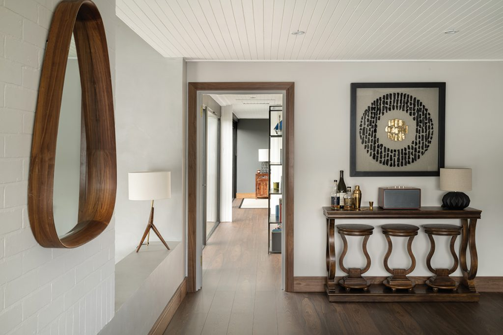 hallway-with-console-table-and-wooden-mirror