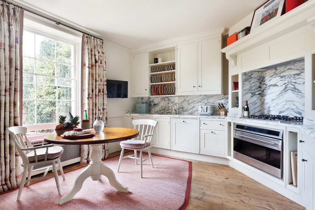 kitchen-with-dining-table-on-rug-in-centre