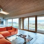 living-room-with-log-burner-and-orange-sofa