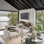 living-room-with-windows-facing-out-into-the-water