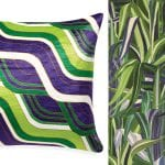 jonathan-adler-cushion-and-purple-patterned-wallpaper