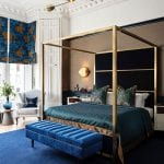 four-poster-gold-bed-in-blue-bedroom