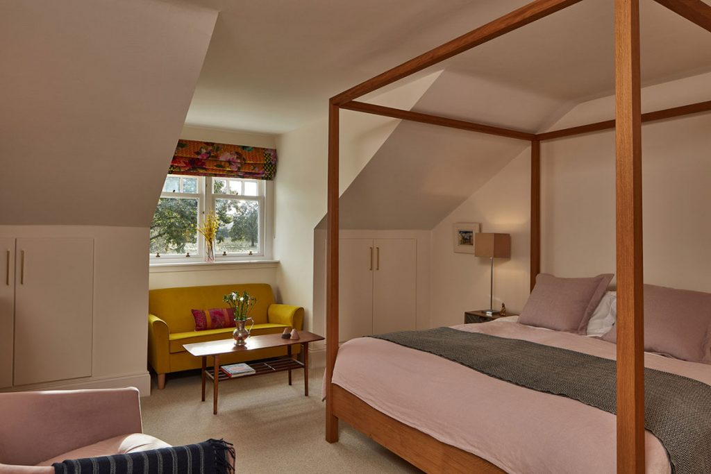 pink-bedroom-with-sloped-ceiling