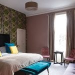 Saorsa-hotel-pink-room-with-blue-cushions-on-bed