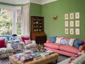 green-living-room-with-view-to-bay-window
