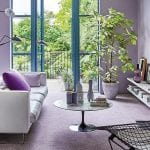 lilac carpeted living room with floor to ceiling French windows