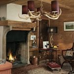 cosy hunting lodge theme lounge with antler chandelier