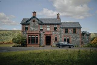 Dun Aluinn exterior shot with moody feel: large Victorian house