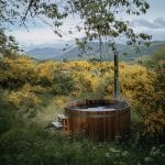 Wood fired hot tub nestled in the woodland