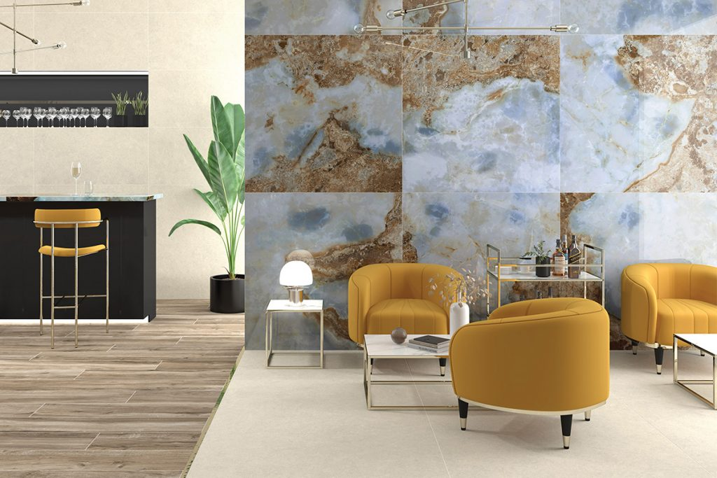 open plan living room with bar area, agate walls and yellow puddle armchairs