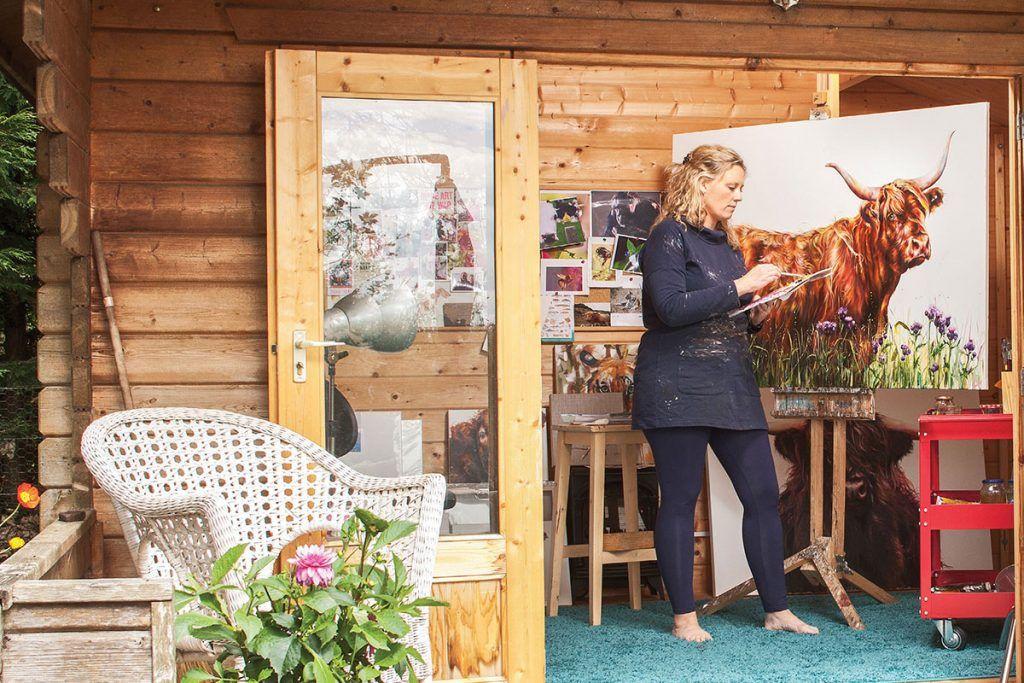 Georgina-mcmaster-painting-a-highland-cow.jpg