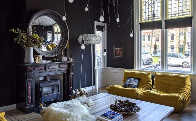 dark-living-room-with-yellow-accents.jpg