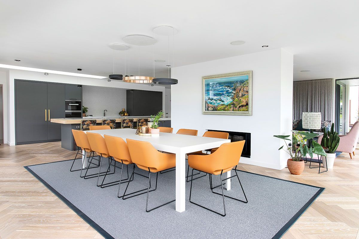 dining-area-in-open-plan-kitchen-with-orange-chairs.jpg