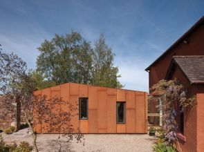 An extension to a barn conversion in Stirlingshire embraces weathered steel and ballet barres
